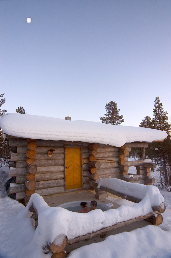 Hot tub outside a log house in winter. SOURCE: Courtesy of Finland Tourist